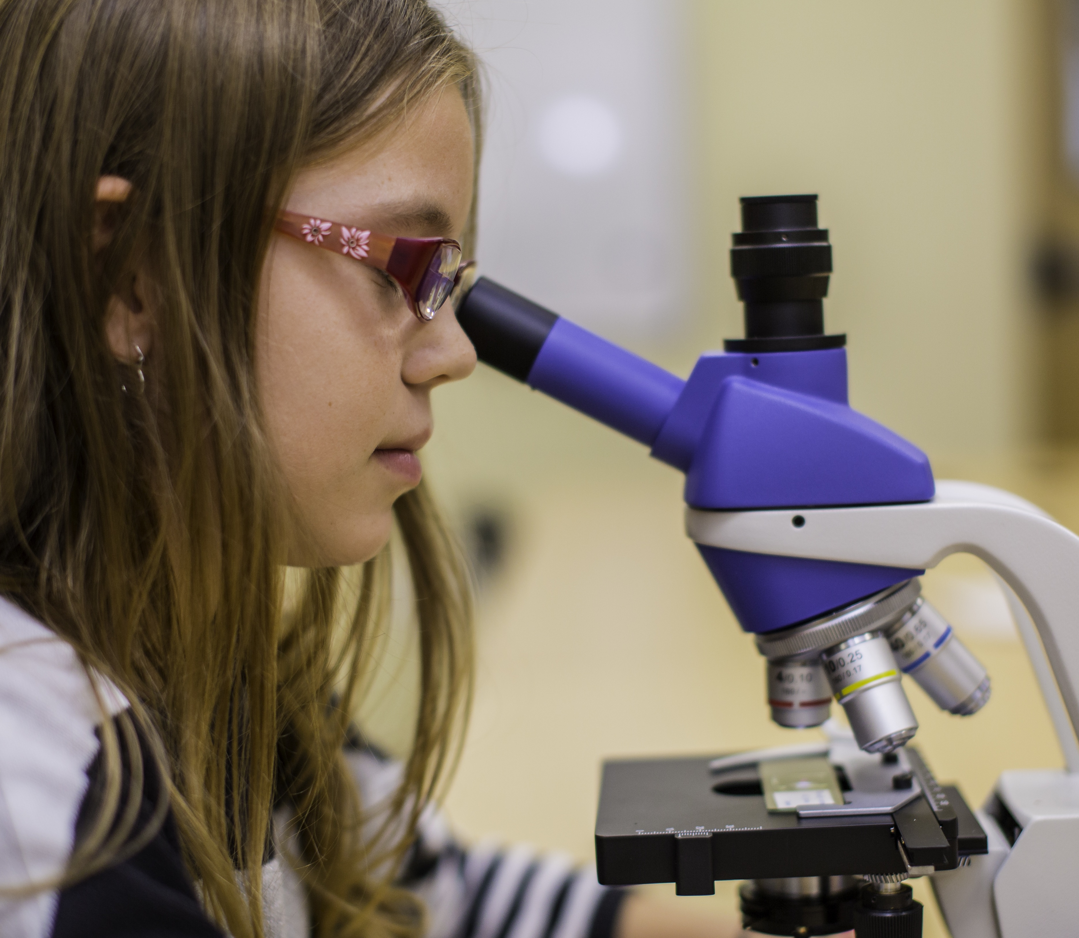MSP student looking through a microscope