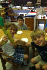 Students cooking plantains during Spanish week at summer camp