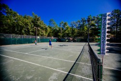 Students playing tennis on the MSP tennis courts